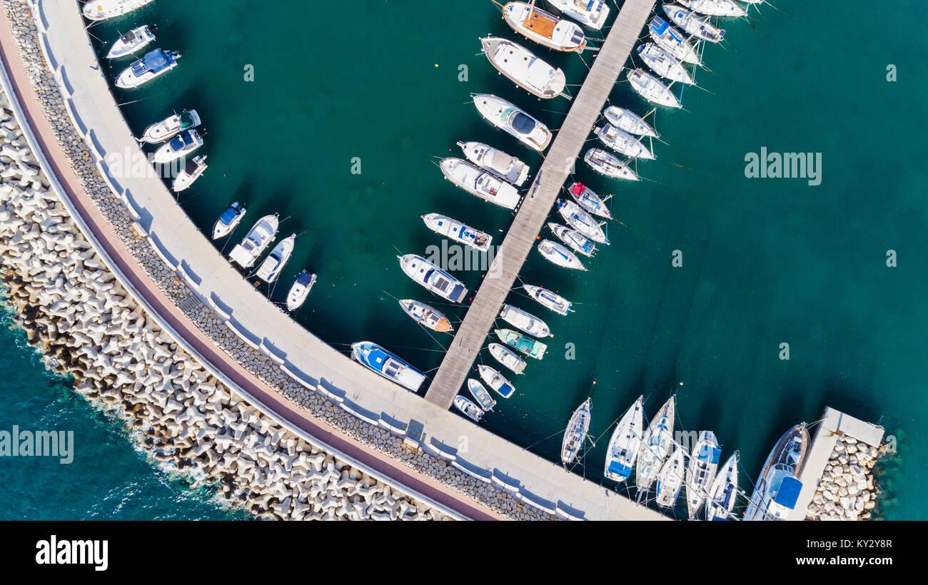 Aerial bird's eye view of Zygi fishing village port, Larnaca, Cyprus. Bird eye view of aligned fish boats moored Stock Photo