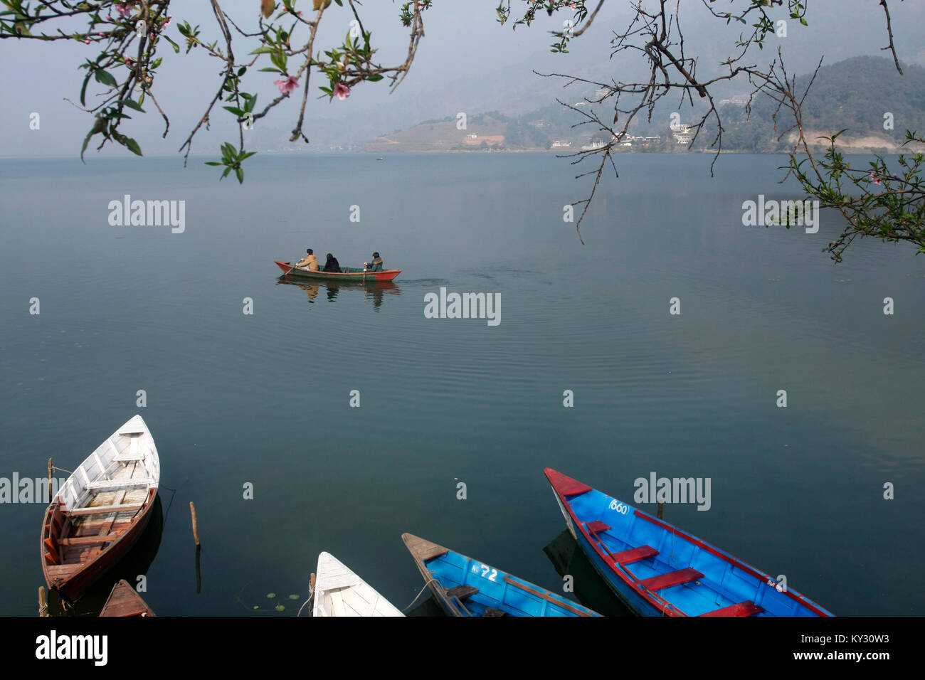People boating in Fewa lake in Pokhara. - Stock Image