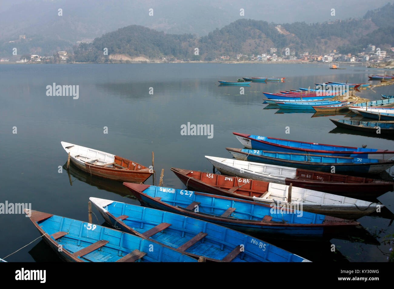 Colorful wooden boats in Fewa lake Pokhara. - Stock Image