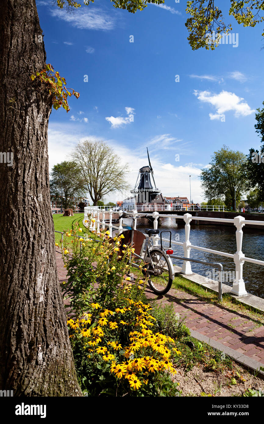 Haarlem, Netherlands. De Adriaan, landmark windmill in the centre of Haarlem on the Spaarne river Bicycle parked - Stock Image
