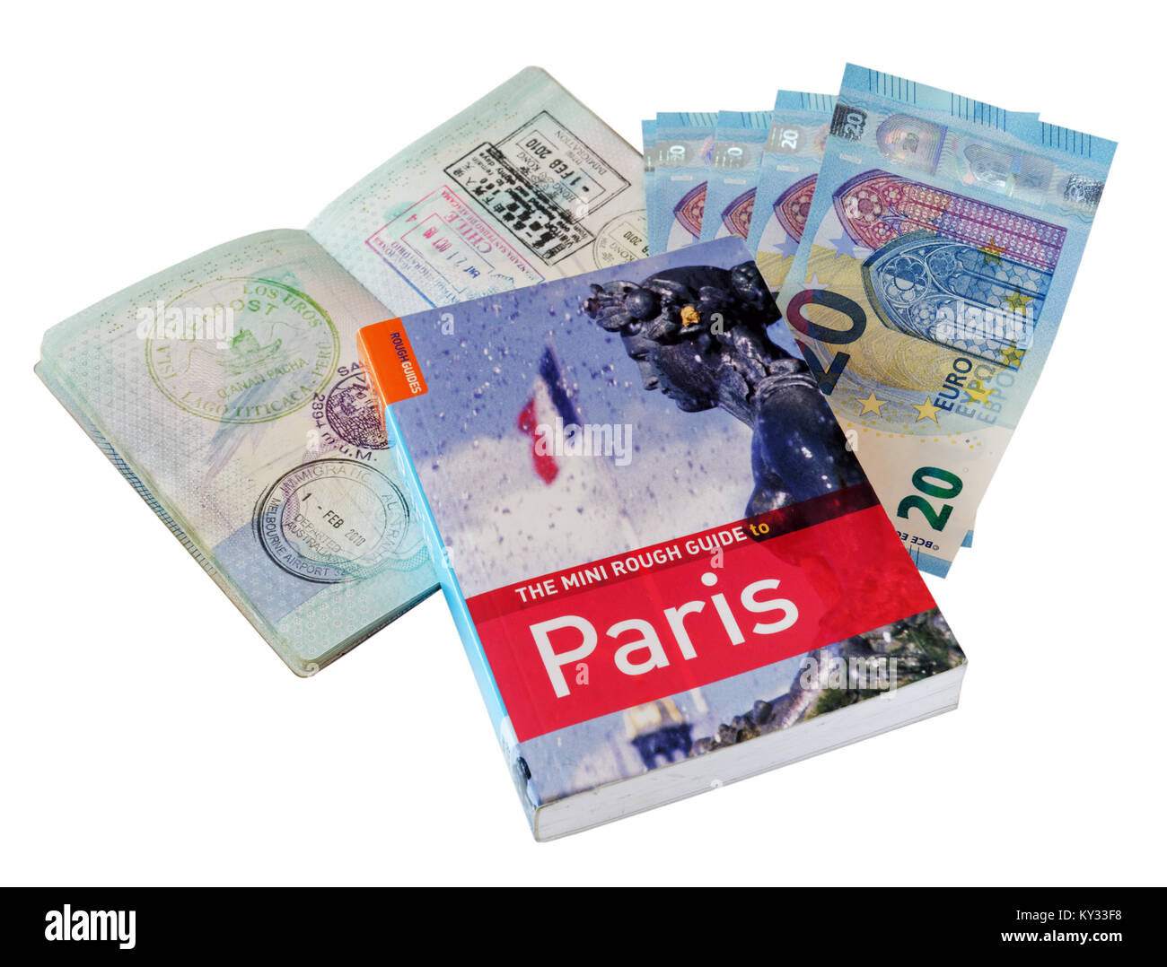 The Rough Guide guide to Paris, with a UK passport and Euro currency - Stock Image