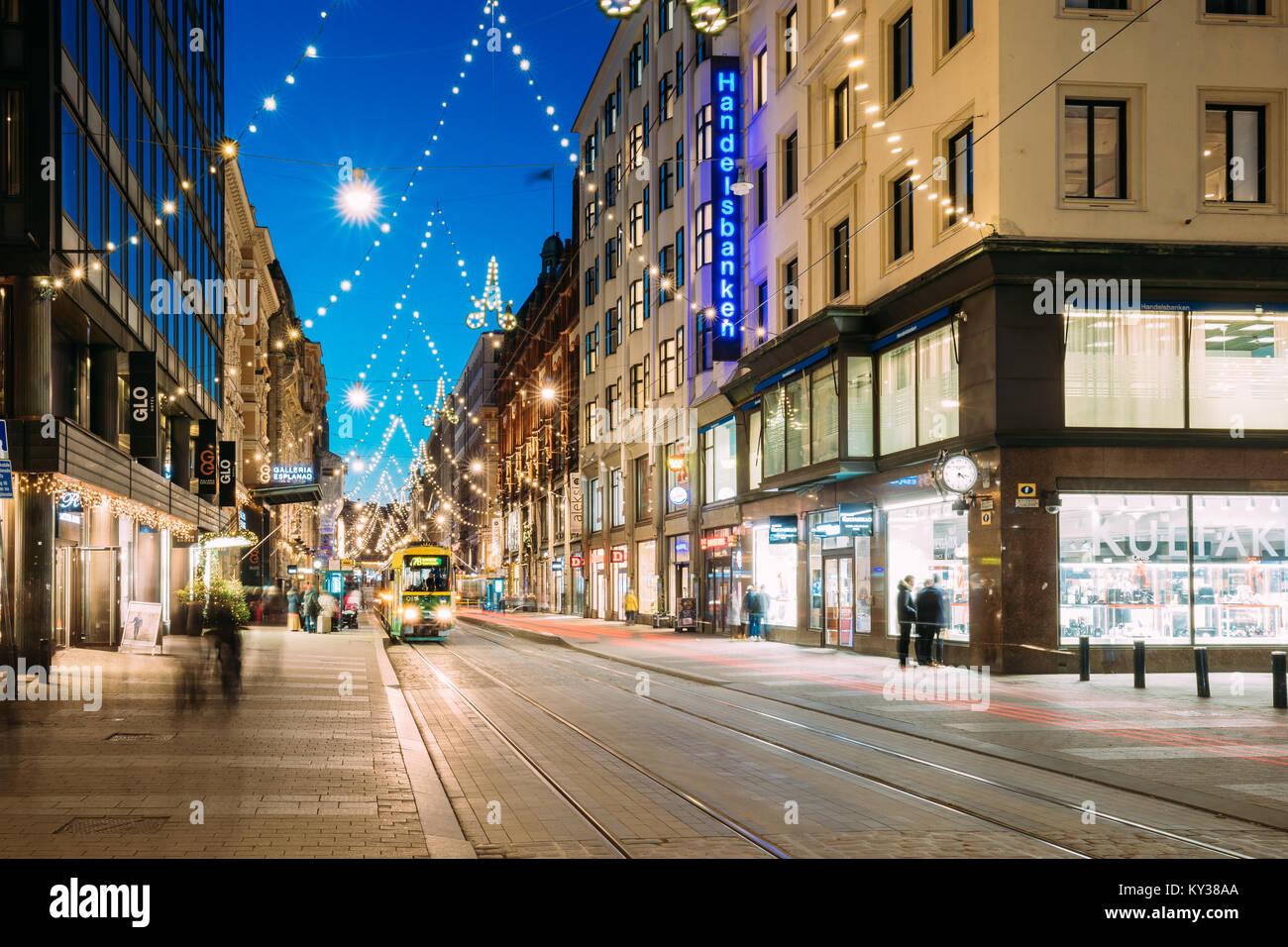 Helsinki, Finland - December 6, 2016: Tram Departs From Stop On Aleksanterinkatu Street. Street With Railroad In - Stock Image