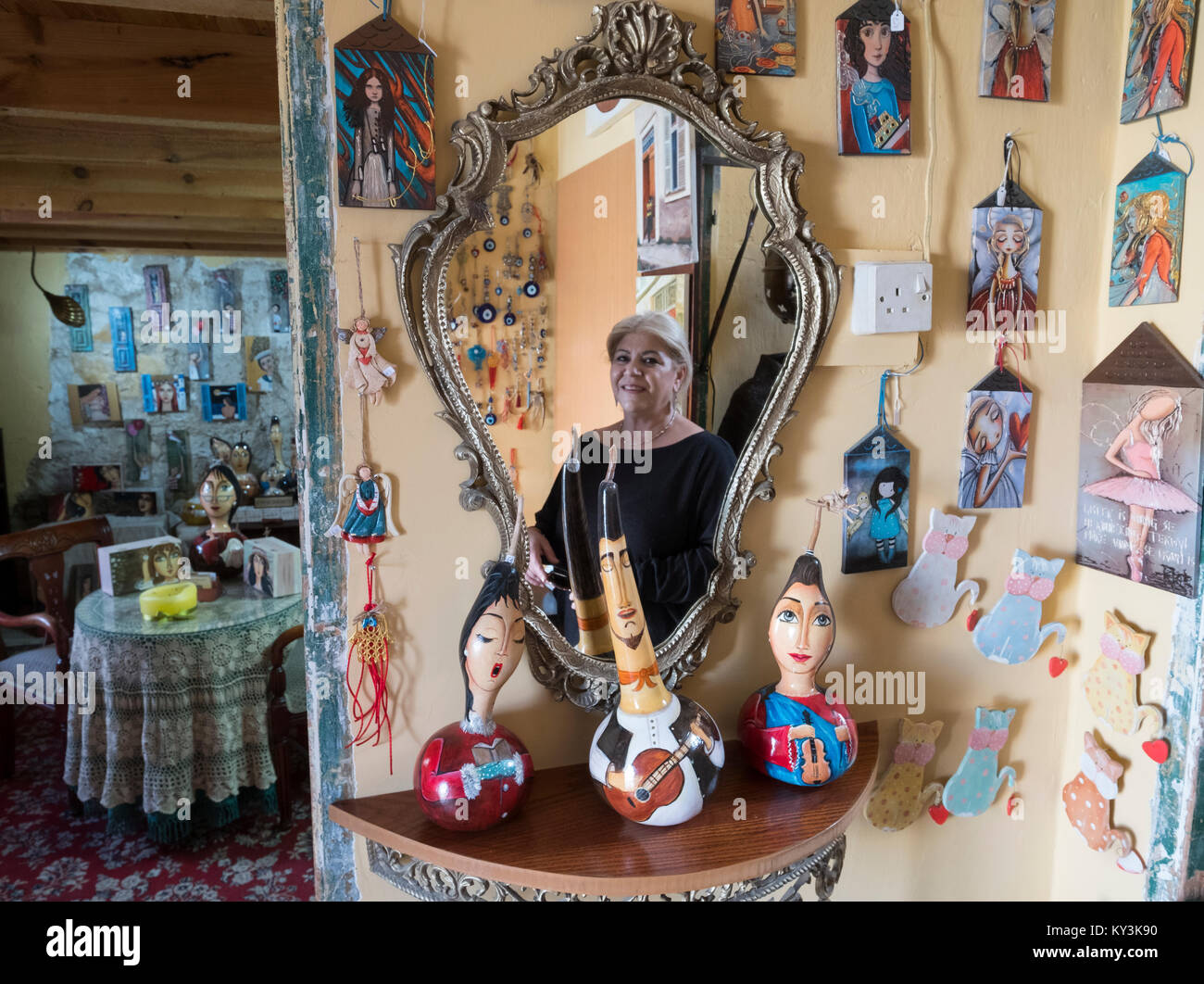 Painted faces on pumpkins and other art works in a small souvenir shop in Paphos old town centre. - Stock Image