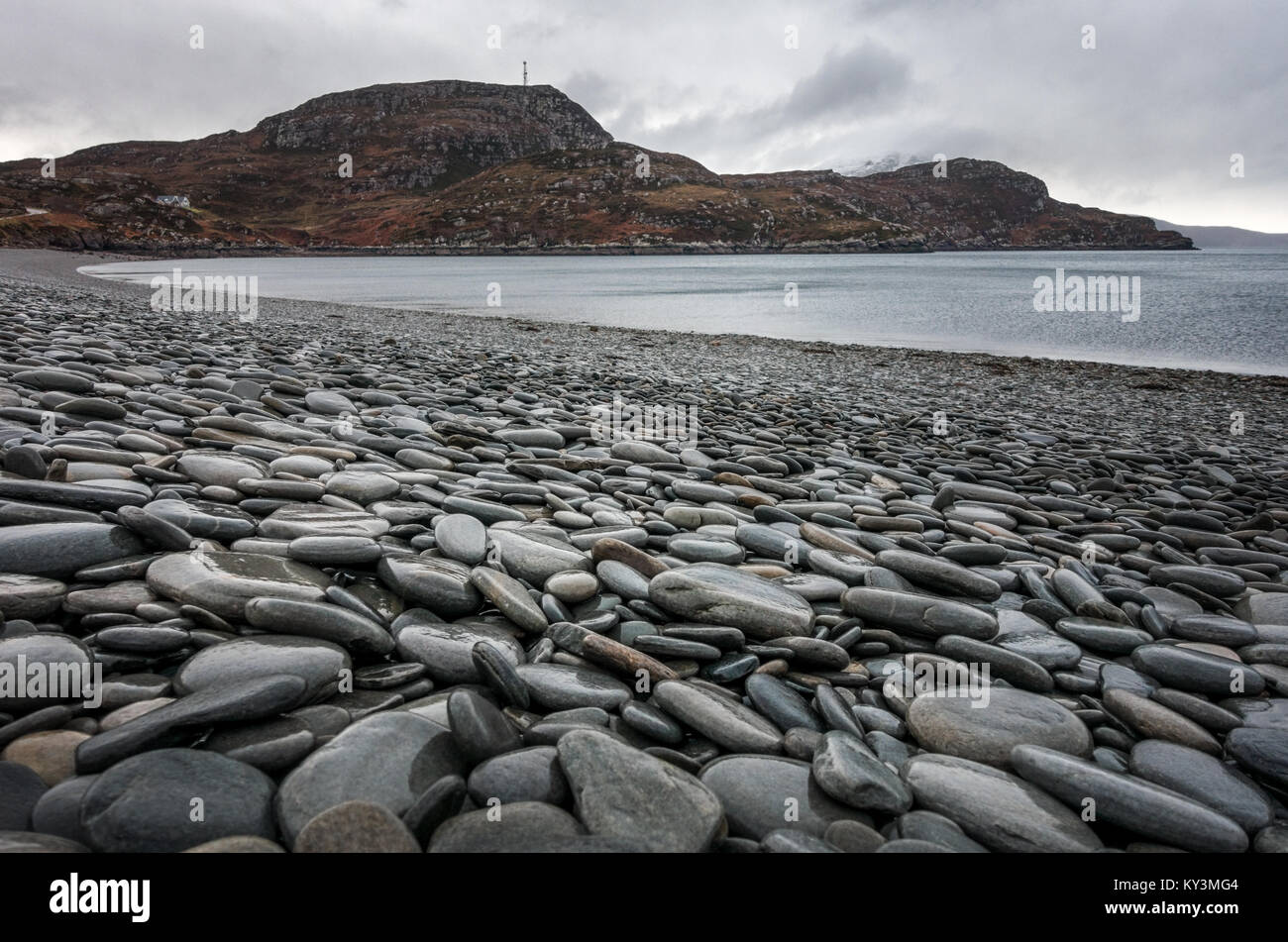 Beautiful flat pebbles on the pebble beach at Ardmair, near Ullapool, Scotland - Stock Image