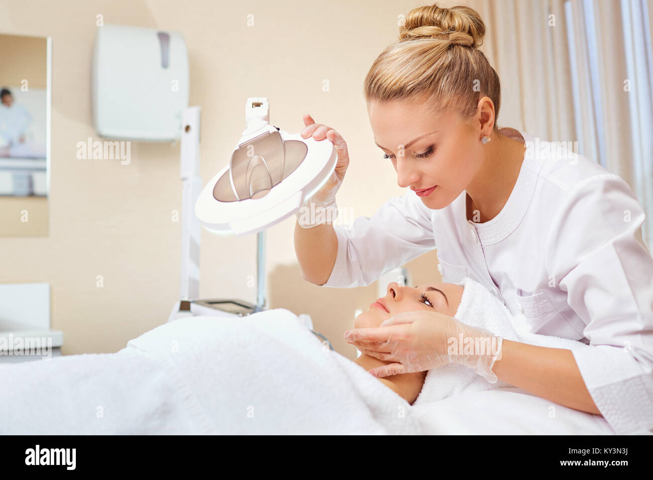 Cosmetologist is a professional with a patient in the office of - Stock Image
