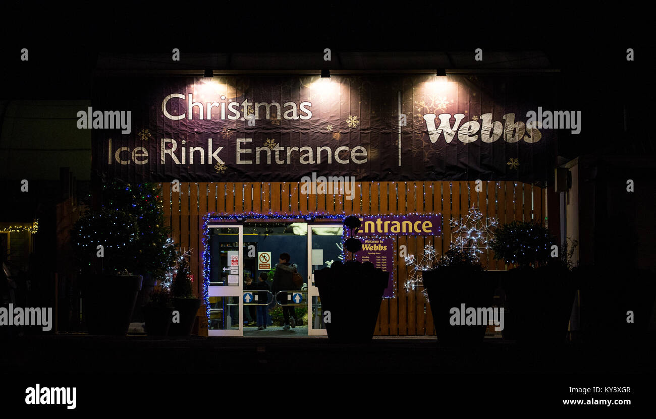 Evening skating at the Christmas Ice Rink at Webbs of Wychbold Garden Centre, Worcestershire, 23rd December 2017. - Stock Image