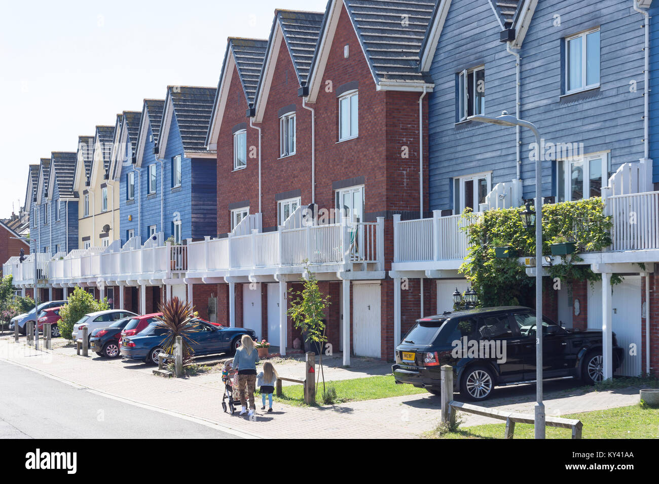 Modern terraced houses, West Quay, Newhaven, East Sussex, England, United Kingdom - Stock Image