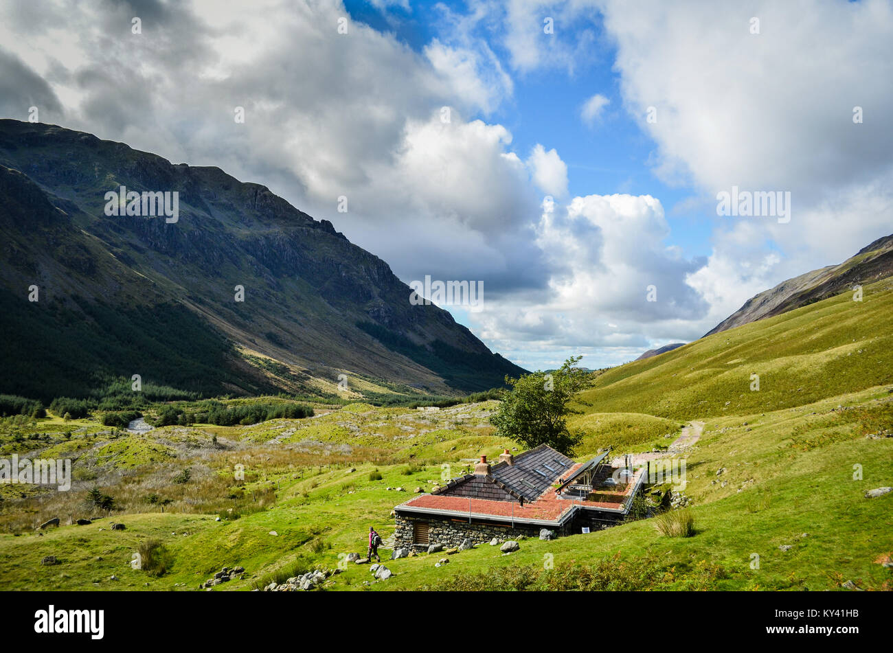 hiker, Black Sail Hut, England's Coast to Coast Path, looking toward Ennerdale Water. - Stock Image