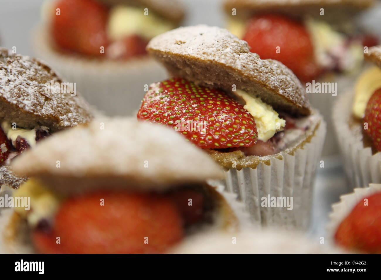 Homemade strawberry and cream cupcakes. - Stock Image