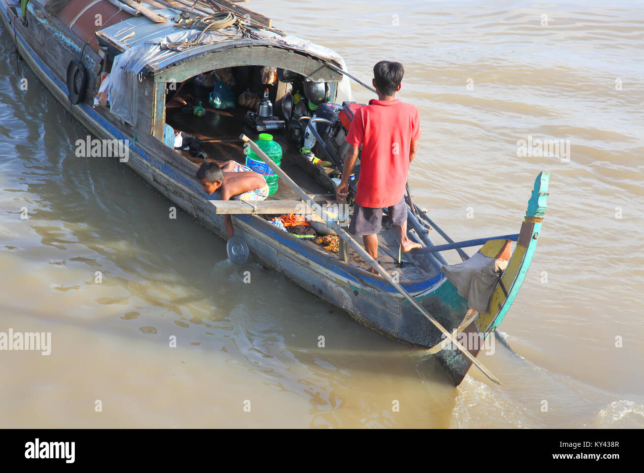 washing dishes in the river at chau doc vietnam - Stock Image