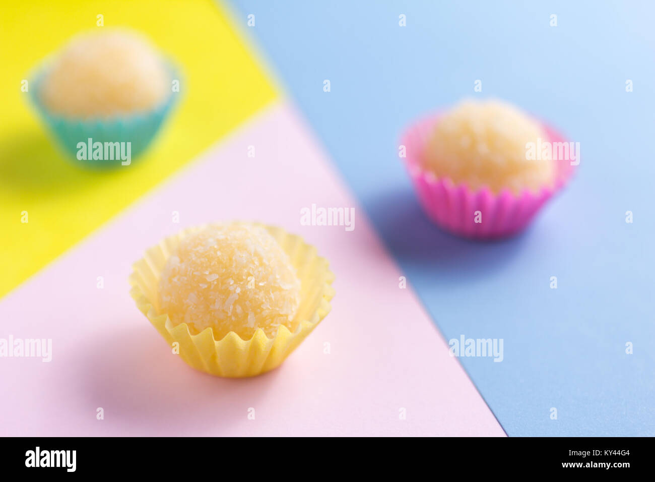 Beijinho is a handmade candy from Brazil. Made with condensed milk and coconut. Children brithday party sweet. Spread Stock Photo