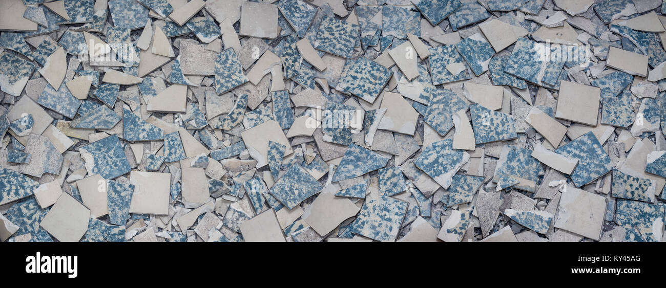 Texture from broken tiles. Background from fragments of old retro floor. Concept for renovation and modernization - Stock Image