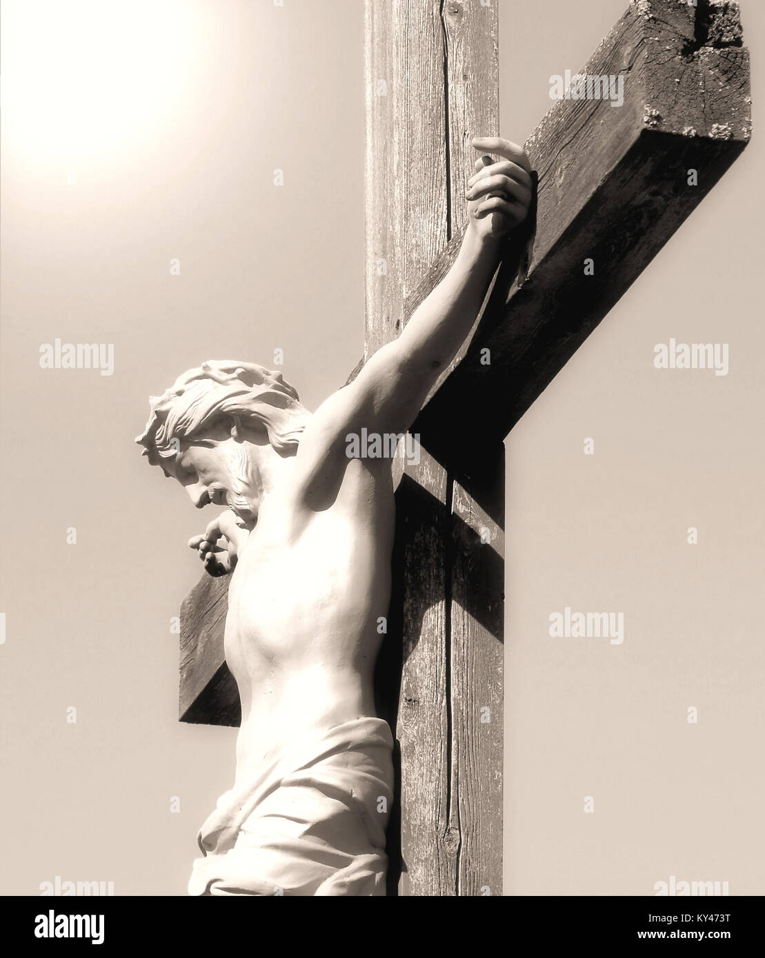 The Crucifixion - Christ nailed to a wooden cross, light shines from above - Stock Image