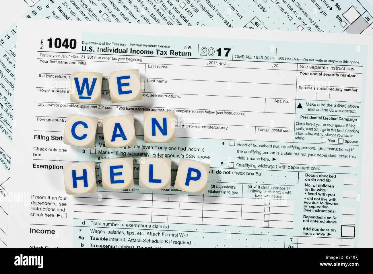 form 1040 help  Macro close up of 17 IRS form 17 with WE CAN HELP ...