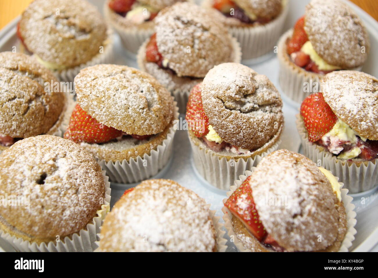 Homemade strawberry and cream cupcakes. - Stock Image
