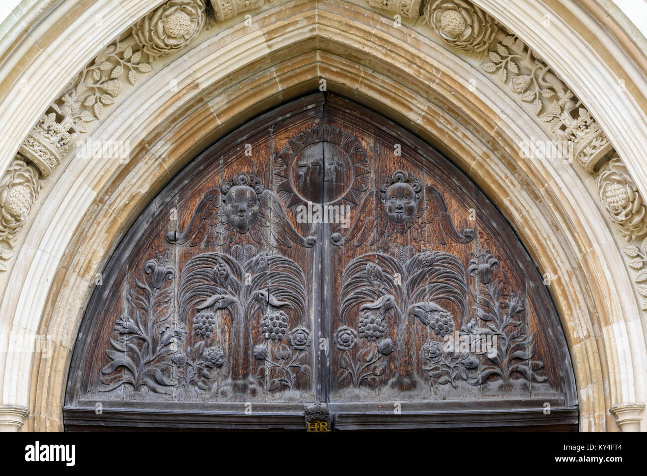 Wooden carvings on the top section of the west door at the chapel of King's college, university of Cambridge, - Stock Image