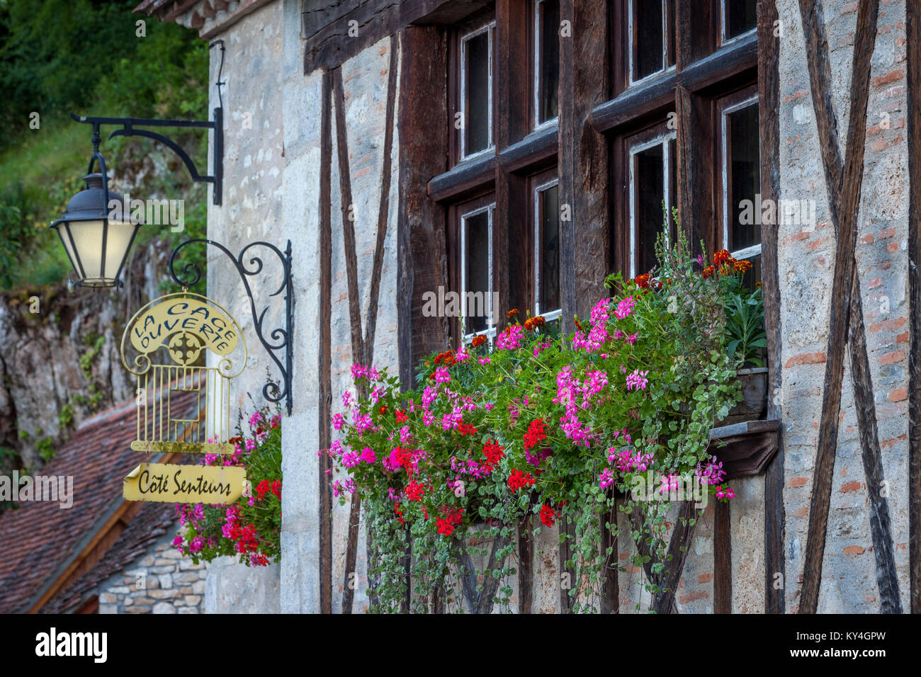 Ancient window and flower box on half-timbered building in Saint Cirq Lapopie, Lot Valley, Occitanie, France - Stock Image