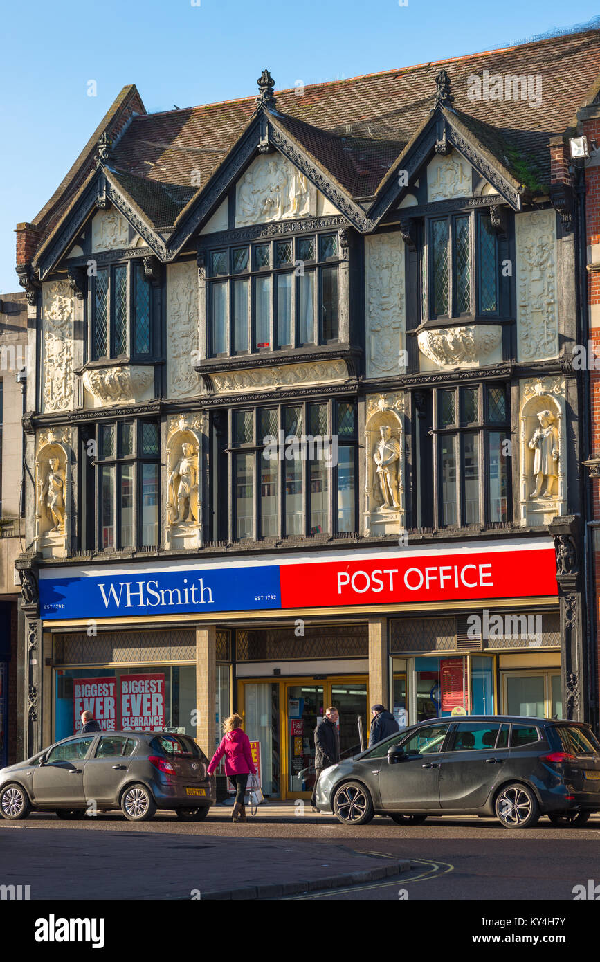 Famous facade above the WH Smith & Post Office, top panel depicts King Canute demonstrating his fallibility - Stock Image
