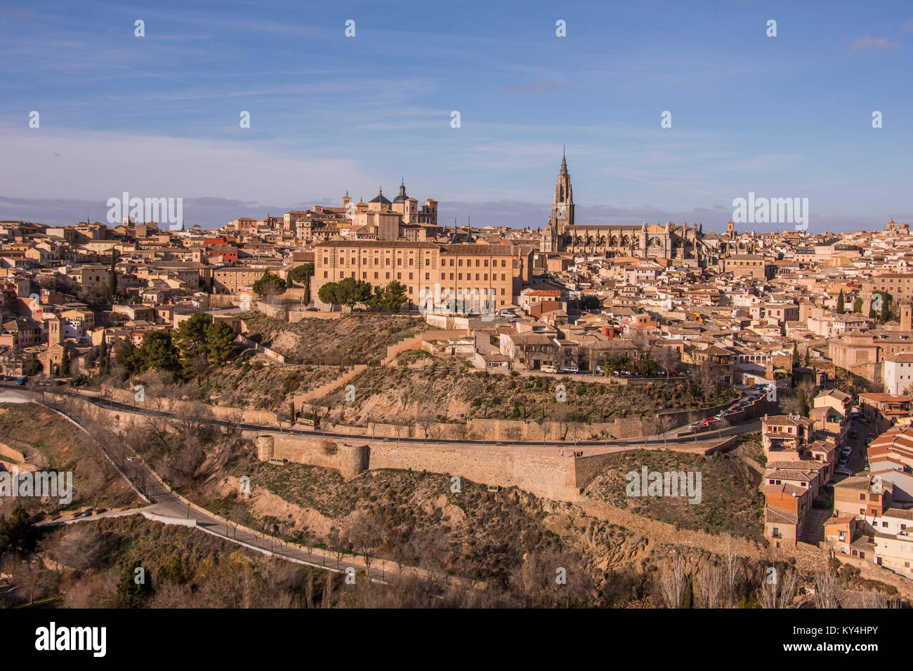 Panoramic view of the city walls of Toledo, medieval buildings and Saint Mary's Cathedral. Spain. Stock Photo