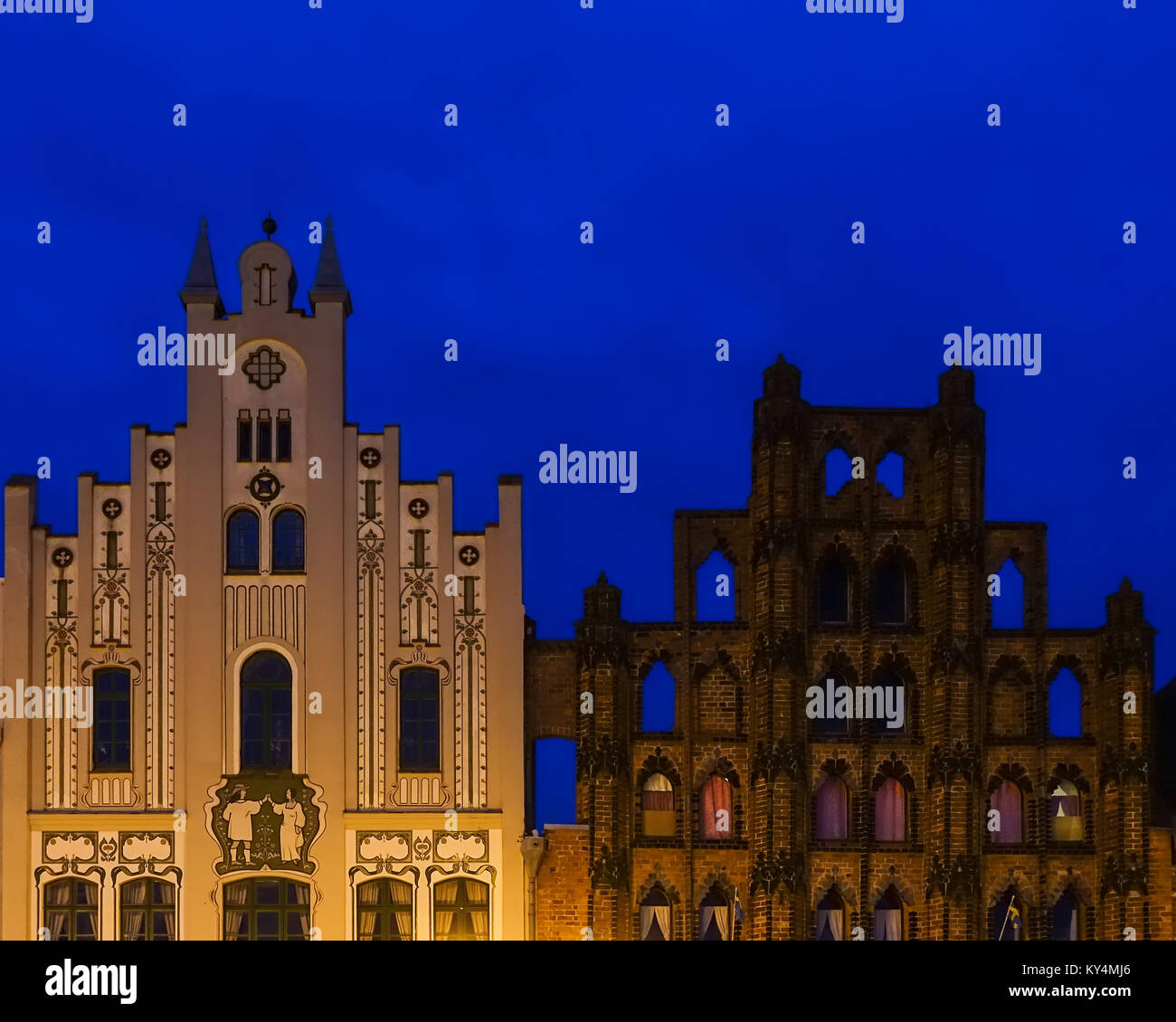Gables of two historical buildings in Wismar at blue hour - Stock Image