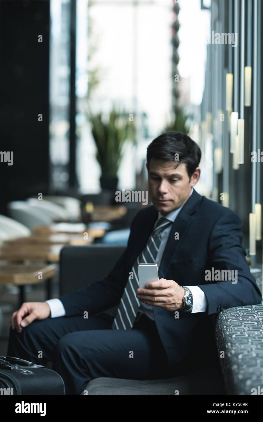 Businessman using mobile phone - Stock Image