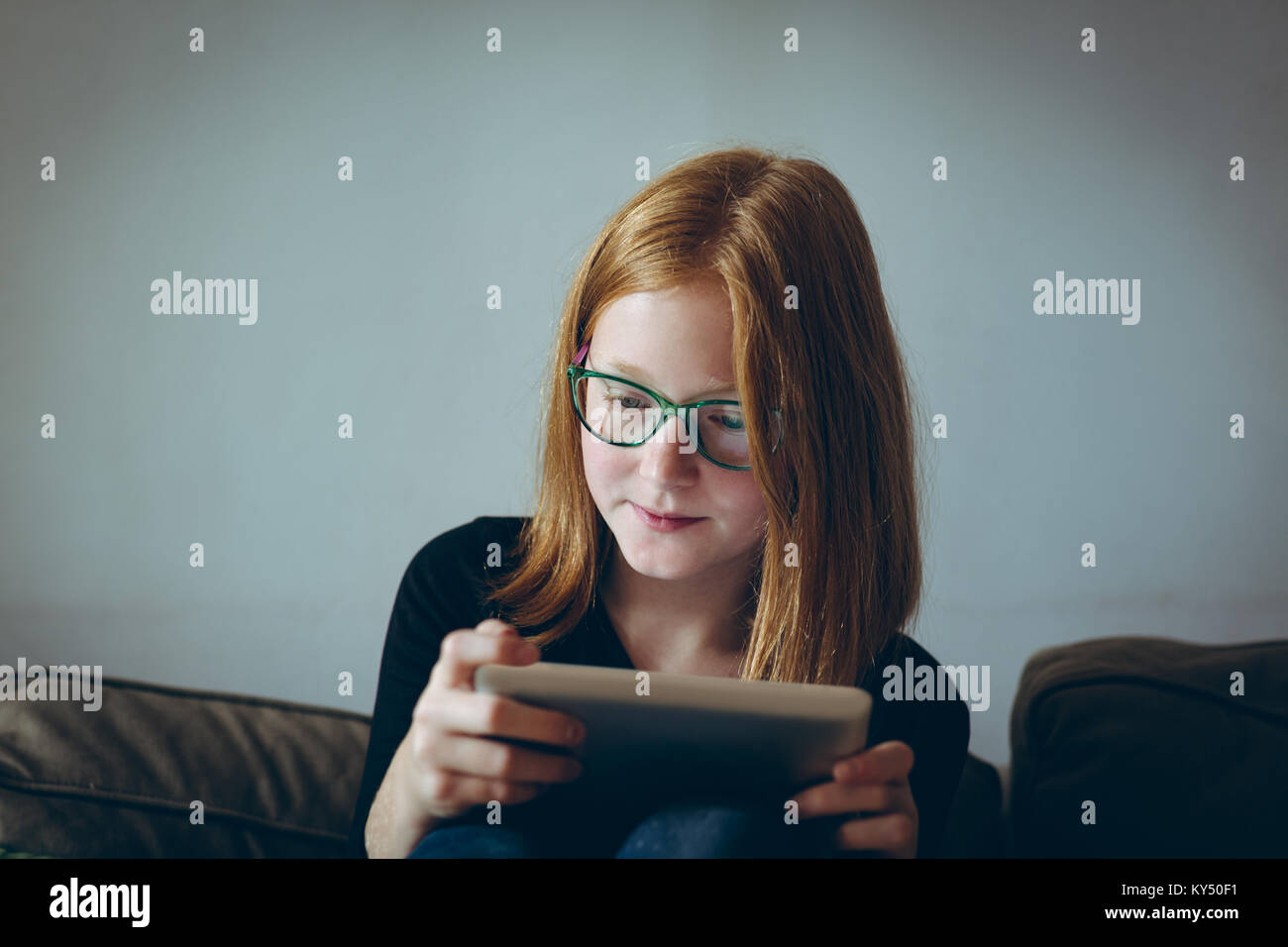 Girl using digital tablet - Stock Image