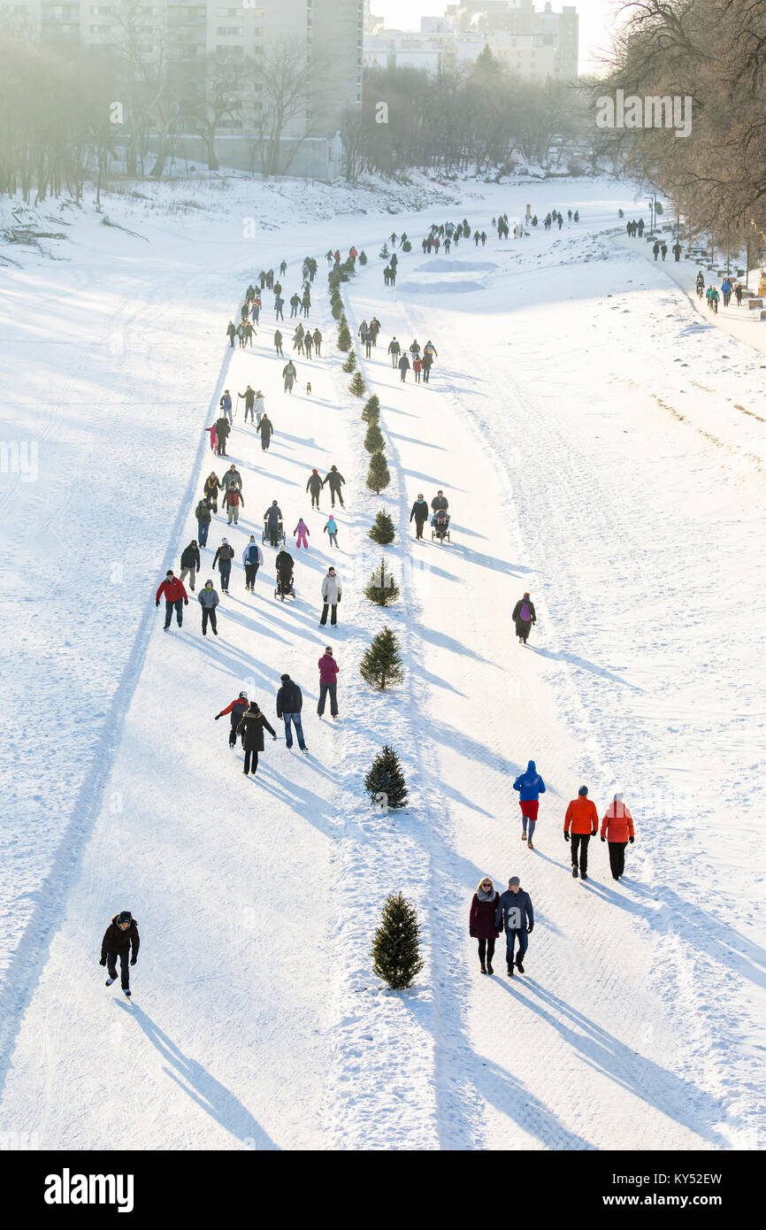 Ice skating on the Assiniboine River, part of the Red River Mutual Trail at The Forks, Winnipeg, Manitoba, Canada. - Stock Image