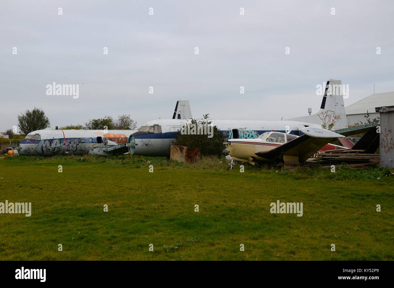 Three aircraft in the grounds of Skylark Hotel near Southend Airport initially planned to be restored for static - Stock Image