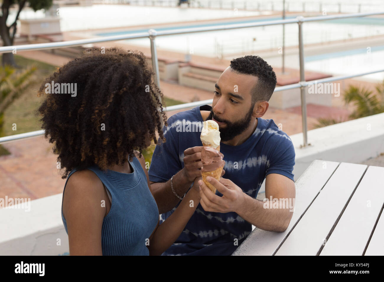 Couple having ice cream at promenade - Stock Image