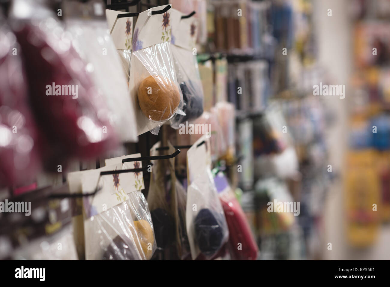 Pack of woollen ball display in the shop - Stock Image