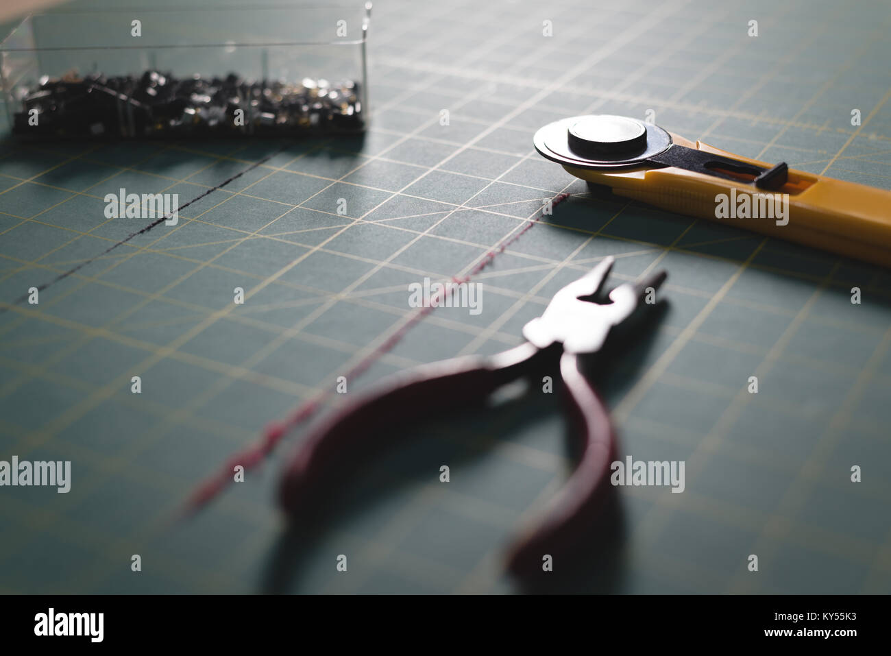 Pliers and blade on table - Stock Image
