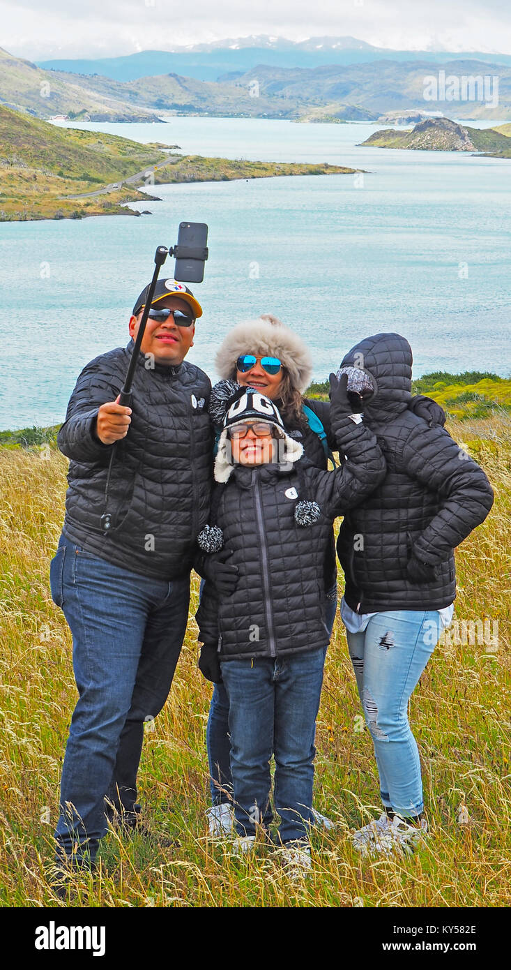 Family doing a selfie photo in Torres del Paine National Park in Chile. - Stock Image