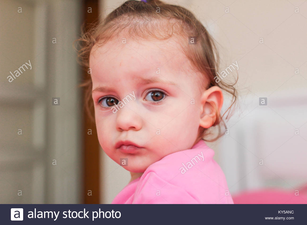 innocent face expression of a little cute baby stock photo