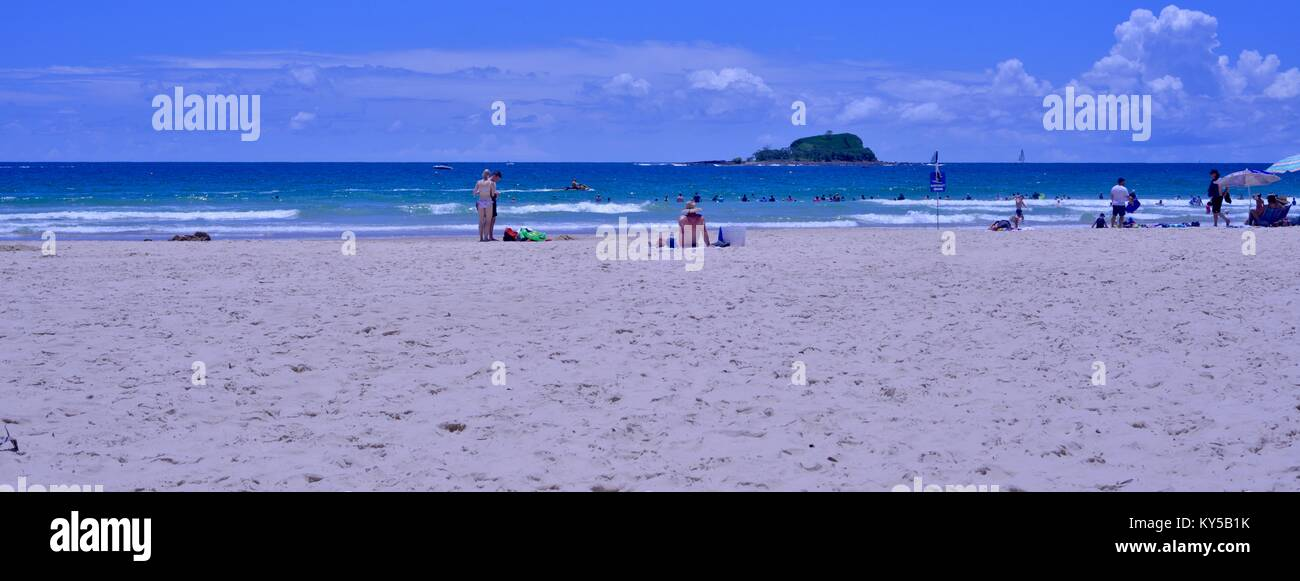 People staying cool at the beach, Mudjimba beach, Sunshine coast, Queensland, Australia - Stock Image