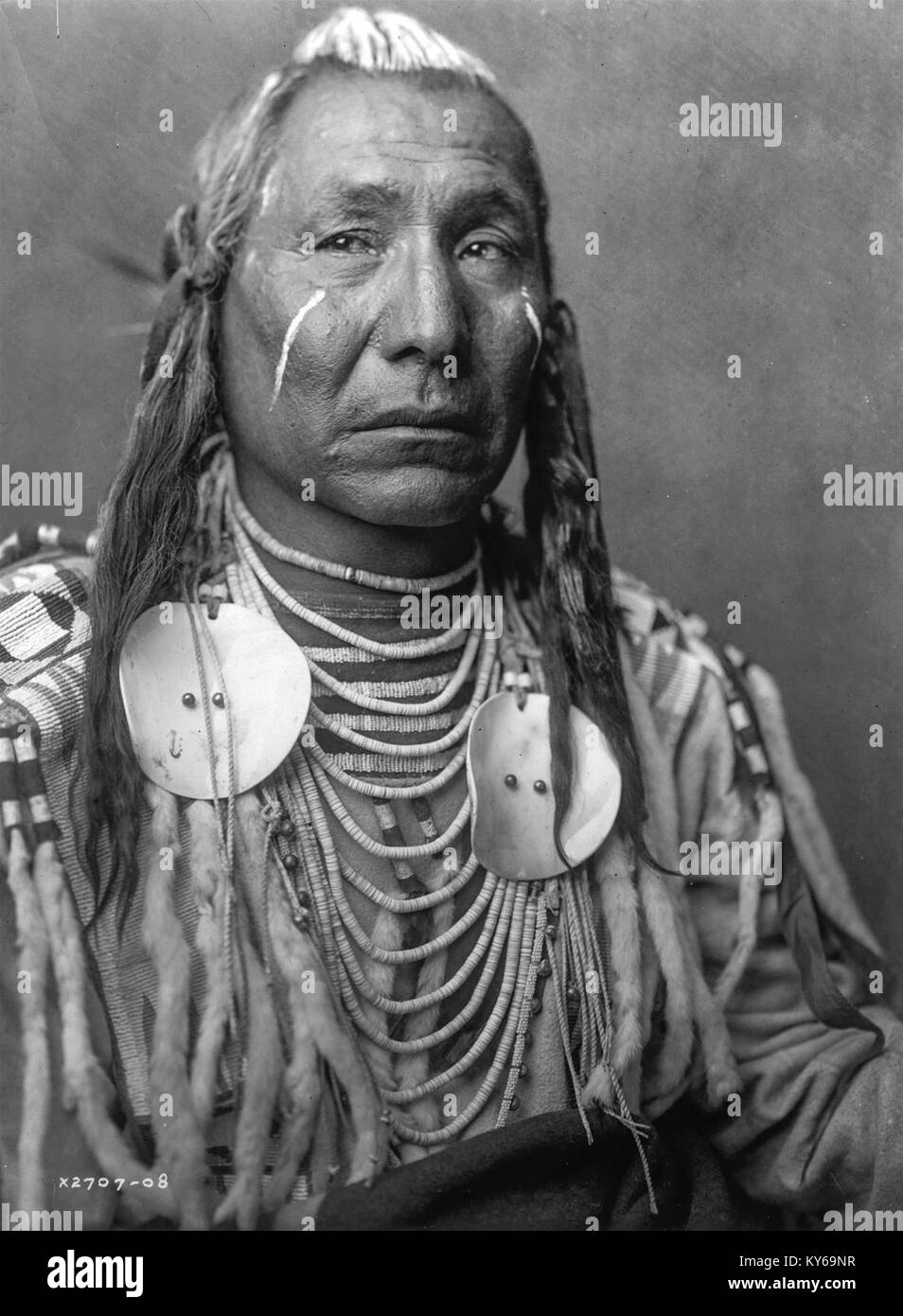 Black and white photo of native american indian chief in traditional costume