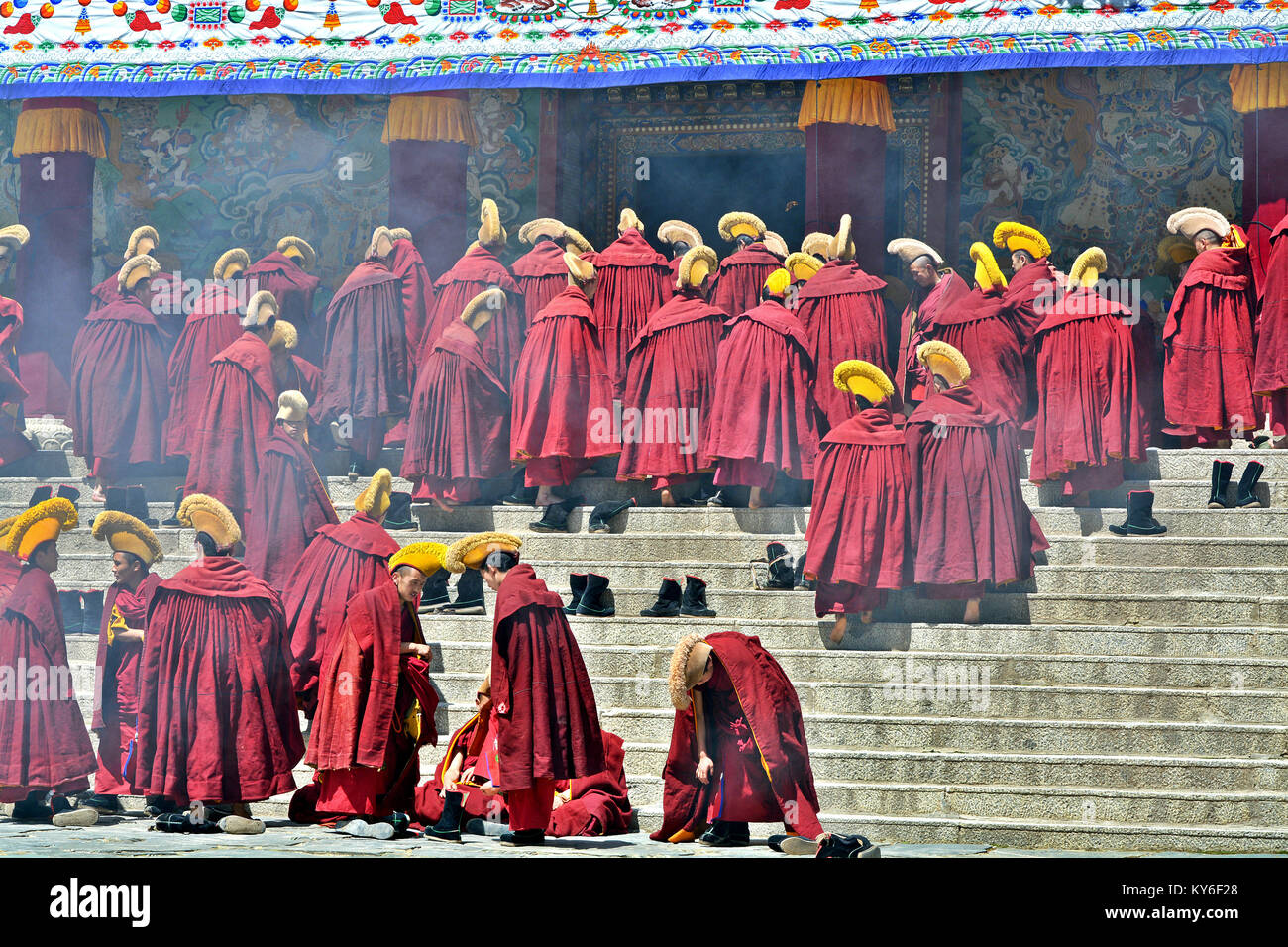 It is Assembly time for the Tibetan yellow hat monks in the main hall of  Labrang monastery in Xiahe, Gansu province, - Stock Image