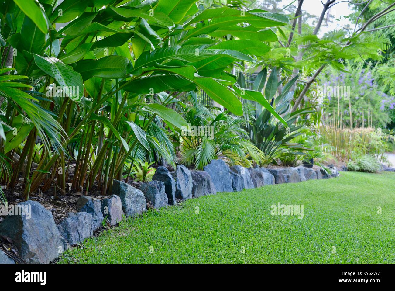 Large Stone Border Separating Lawn From A Garden Bed, Sunshine Coast,  Queensland, Australia