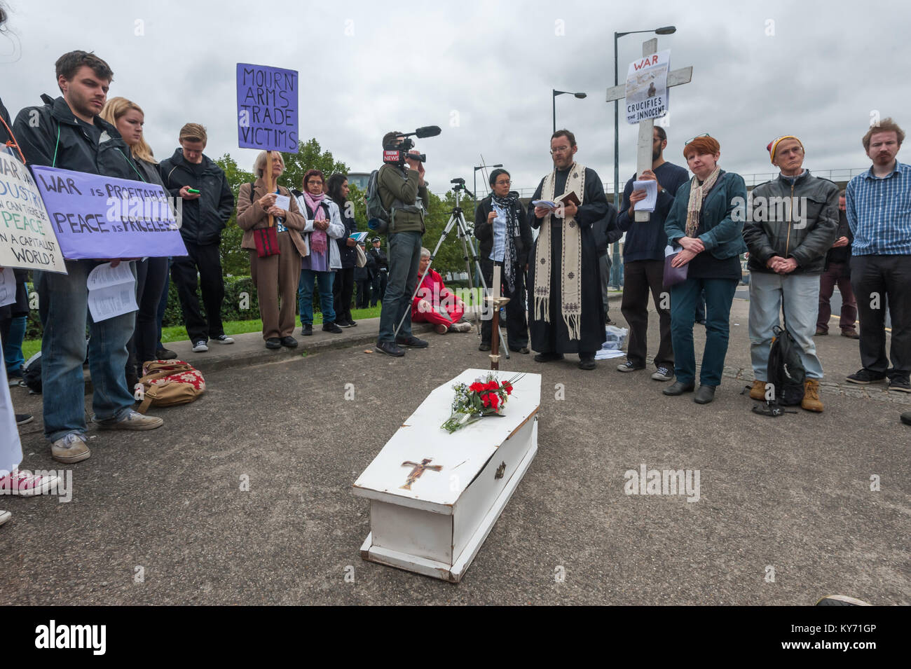 The mock funeral by London Catholic Workers for victims of the arms trade next to the road leading to the ExCeL Stock Photo