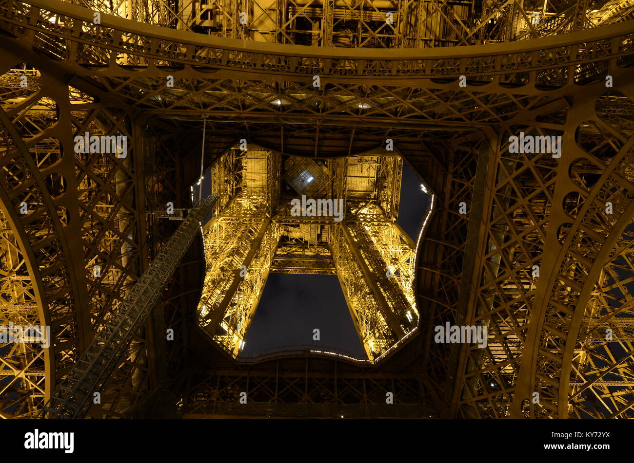 Eiffel Tower illuminated at night from below. Paris, France. Space for copy - Stock Image