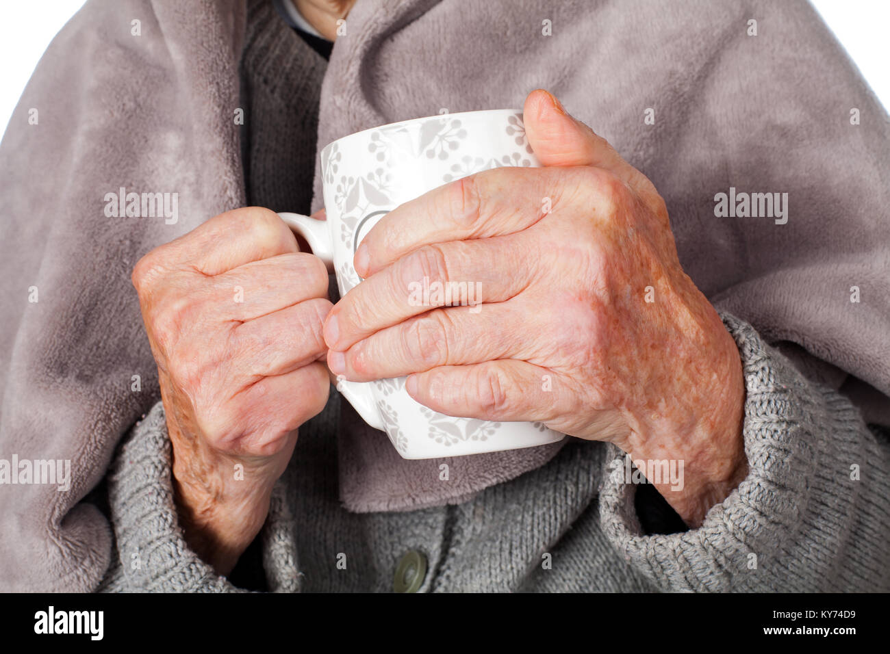 Senior ill woman on isolated covered by a warm blanket - Stock Image