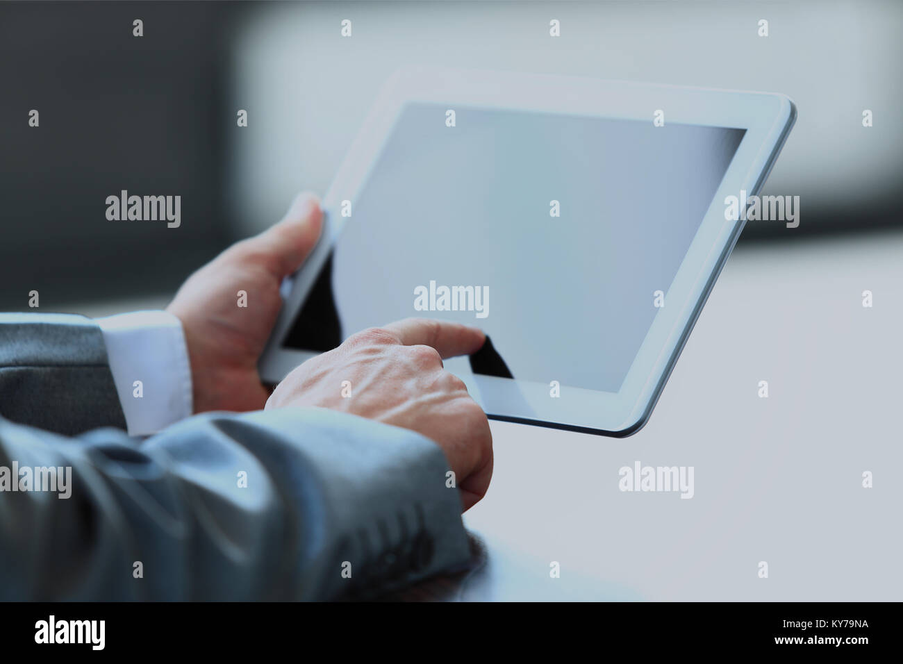 Businessman holding digital tablet. - Stock Image