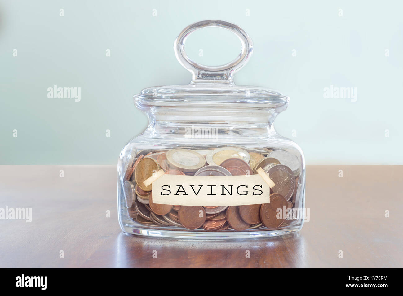 savings concept. glass jar full of coins - Stock Image