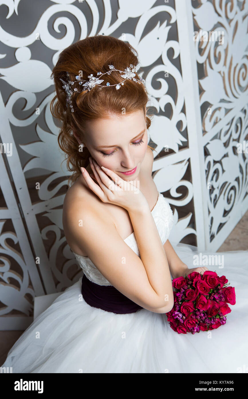 Beautiful Red Hair Young Woman In White Wedding Gown With