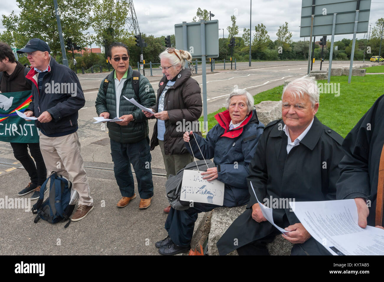 Bruce Kent (right) and others at the Pax Christi led 'Prayers of Repentance' outside the ExCeL centre where the Stock Photo