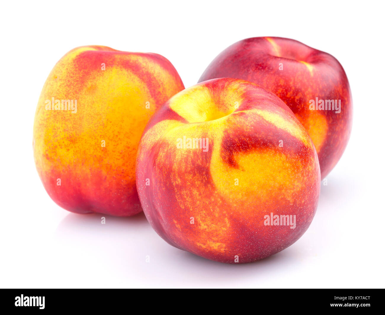 Whole nectarine fruit isolated on white background - Stock Image