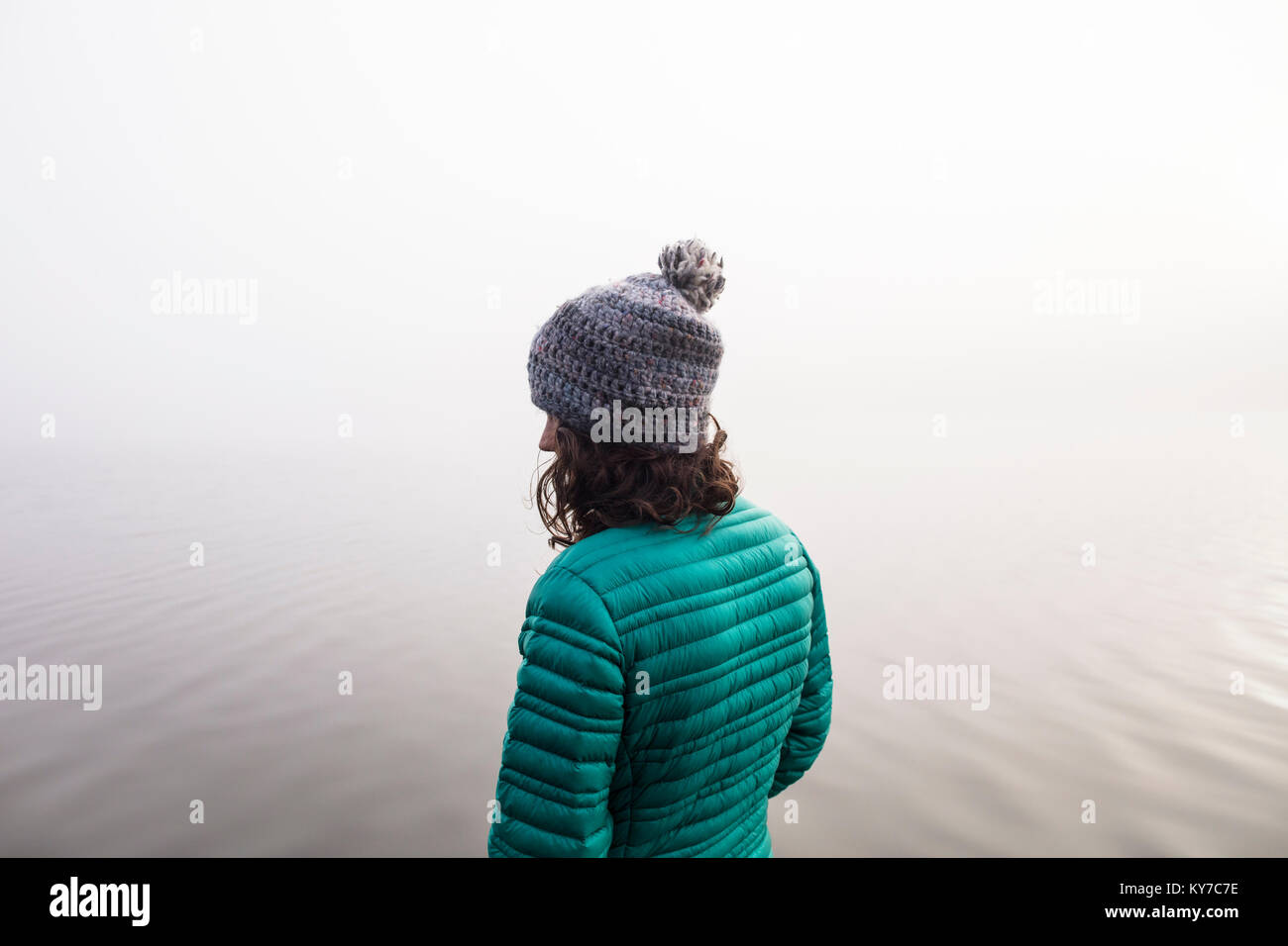 MAYNOOTH, ONTARIO, CANADA - October 18, 2017: A lady looks at a foggy lake in the autumn. - Stock Image
