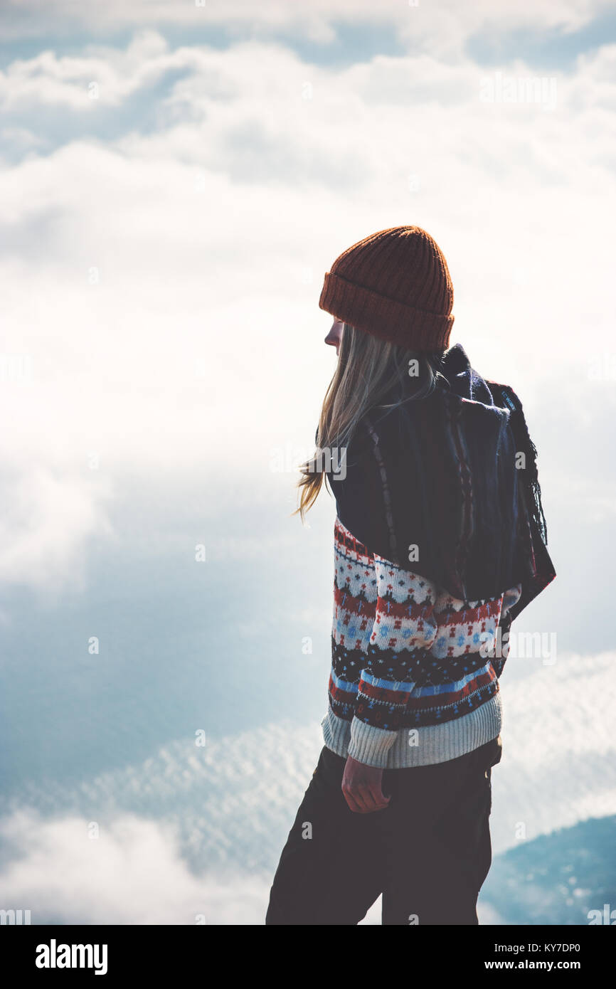 Woman on mountain summit foggy clouds landscape on background Travel Lifestyle concept adventure vacations outdoor - Stock Image