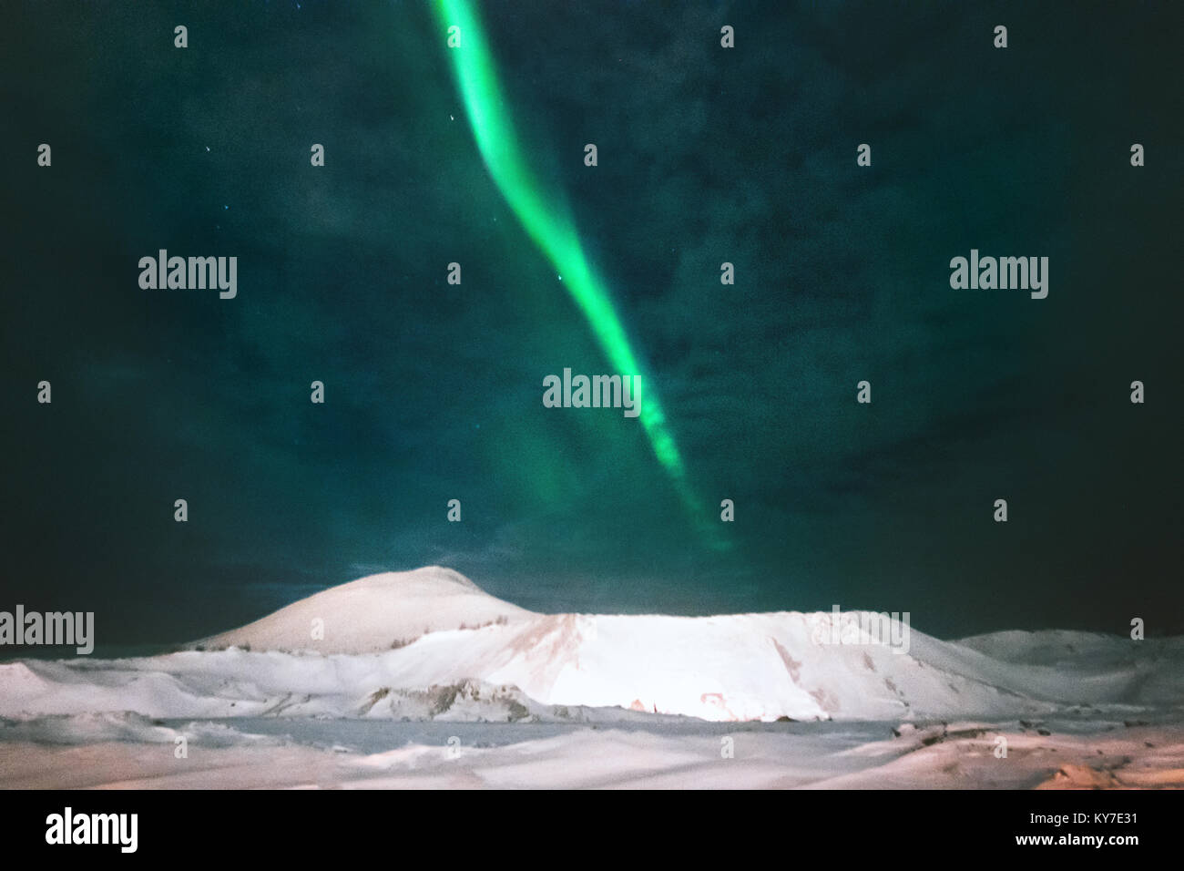 Northern lights Aurora borealis above Mountains Landscape Winter Travel scandinavian night scenery natural colors - Stock Image