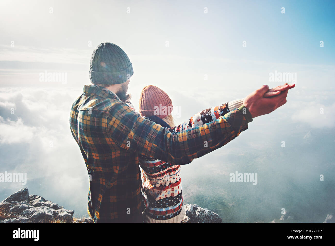 Couple Man and Woman holding hands raised on mountain summit Love and Travel happy emotions feelings Lifestyle concept. - Stock Image