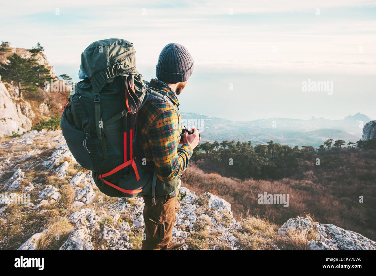 Man Traveler with backpack hiking mountains Travel Lifestyle success concept adventure active summer vacations outdoor - Stock Image